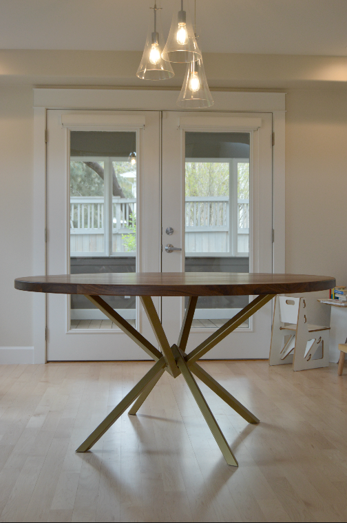 "Solid Walnut ""Flatiron"" Round Table on Steel Peak Base with Brass Powdercoat"