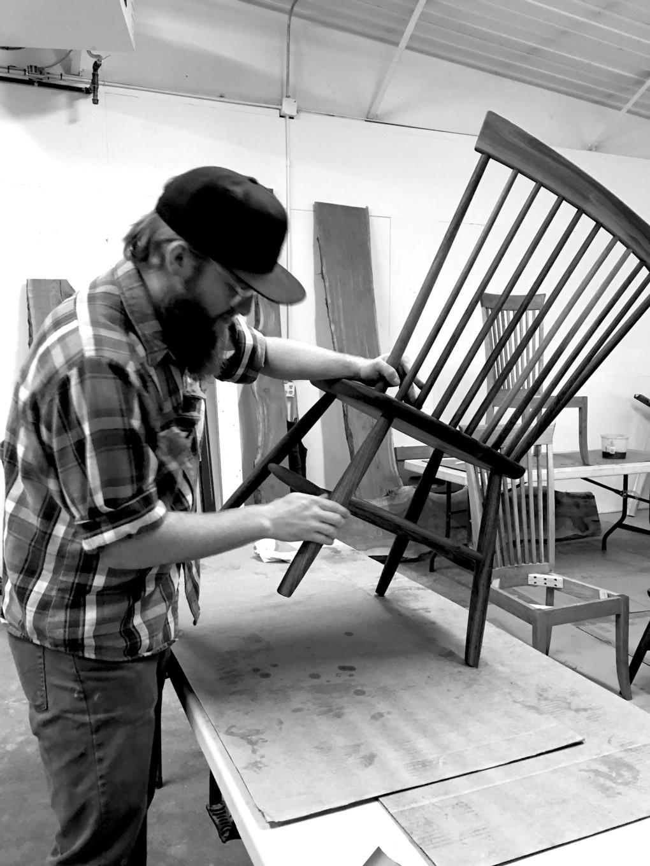 Derrick, sanding chair legs
