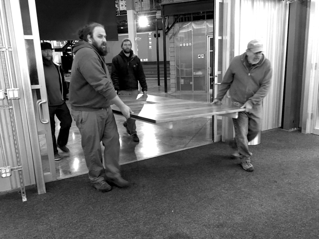 All the beards, bringing one of three giant conference tables into CP+B headquarters