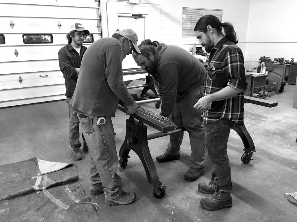 John, Nick, Lee and Nic preparing undermounted cable management