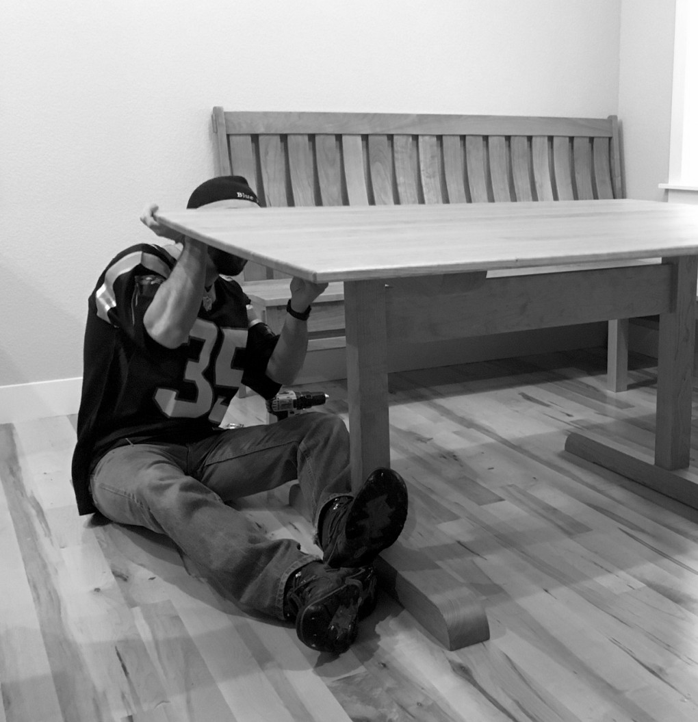 Zach, assembling a trestle Table