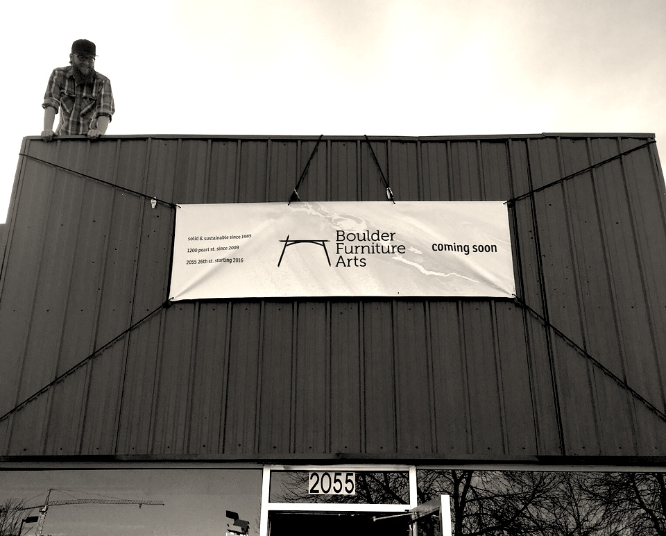 Derrick, hanging our banner at the new showroom!