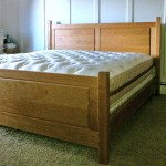 Solid Cherry, double raised panel headboard and footboard.