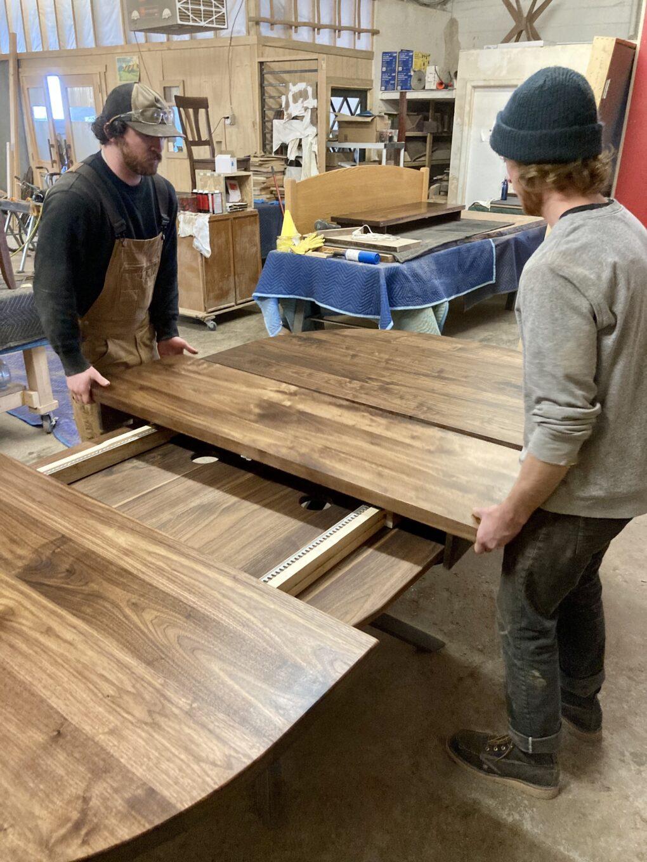 """Custom Solid Walnut """"Flatiron"""" Expandable Oval Table on Steel Peak Base"""